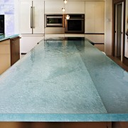 Shimmering glass countertops from ThinkGlass can completely change countertop, floor, flooring, hardwood, interior design, room, swimming pool, table, tile, wood flooring, gray