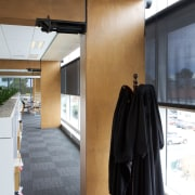 The LVL beams in this Christchurch building feature floor, flooring, interior design, white