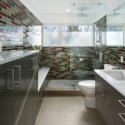 The visual drama in this bathroom comes from architecture, bathroom, floor, interior design, kitchen, real estate, tile, gray, white