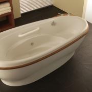 A wood insert defines the Bain Ultra Ayoura bathroom, bathroom sink, bathtub, ceramic, floor, plumbing fixture, product design, toilet seat, brown, black