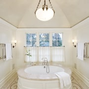 A large round tub with a marble surround bathroom, ceiling, estate, floor, flooring, home, interior design, product, real estate, room, sink, gray
