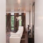 Taking a cue from contemporary luxury hotels, this ceiling, floor, flooring, home, interior design, living room, room, gray