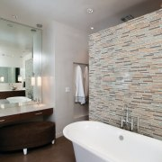 A make-up area is positioned at one end architecture, bathroom, ceiling, floor, flooring, home, interior design, real estate, room, sink, tap, tile, wall, gray