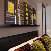 Taking a cue from contemporary luxury hotels, this furniture, interior design, living room, black, gray