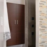 Glass mosaic tiles line this shower room, and bathroom, floor, flooring, interior design, room, gray, brown