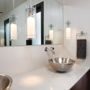 Taking a cue from contemporary luxury hotels, this bathroom, bathroom sink, countertop, floor, interior design, product design, sink, tap, gray