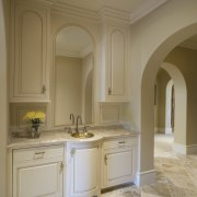 Arched openings lead through to suite to the bathroom, bathroom cabinet, cabinetry, ceiling, countertop, cuisine classique, estate, floor, flooring, home, interior design, kitchen, room, sink, wall, brown, gray