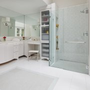 This bathroom bathroom has a walk-in shower on bathroom, bathroom accessory, bathroom cabinet, floor, home, interior design, plumbing fixture, product, room, tile, gray