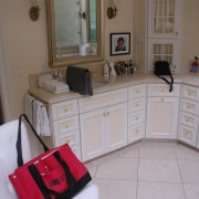 Before remodeling, this bathroom featured fully fitted cabinets cabinetry, countertop, floor, flooring, furniture, home, house, kitchen, property, room, gray