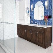 A sense of balance and a subtle nod bathroom, bathroom cabinet, floor, flooring, interior design, room, tile, white