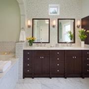 A dark wood vanity, cabinet door and mirror bathroom, bathroom accessory, bathroom cabinet, cabinetry, countertop, cuisine classique, floor, flooring, interior design, kitchen, room, sink, tile, gray