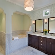 The toilet also has its own alcove with architecture, bathroom, cabinetry, ceiling, countertop, estate, floor, flooring, home, interior design, kitchen, real estate, room, tile, wall, gray