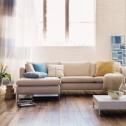 In modern commercial interiors, an eye-catching furnishing scheme angle, chair, coffee table, couch, floor, flooring, furniture, hardwood, home, interior design, laminate flooring, living room, loveseat, product design, room, sofa bed, table, wall, wood, wood flooring, white