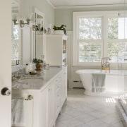 This master bathroom, in a new addition to bathroom, bathroom accessory, bathroom cabinet, countertop, cuisine classique, floor, home, interior design, kitchen, real estate, room, sink, tile, window, gray