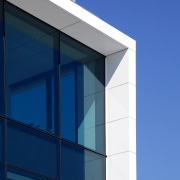 Watercare House in Newmarket boasts a strong street architecture, building, commercial building, corporate headquarters, daylighting, daytime, elevation, facade, glass, line, sky, window, blue