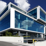 Watercare House in Newmarket boasts a strong street architecture, building, commercial building, condominium, corporate headquarters, elevation, facade, headquarters, home, house, mixed use, property, real estate, residential area, blue, white