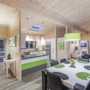Blonded timber lines the walls and ceilings, helping interior design, real estate, gray