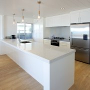 An all-white kitchen keeps the look fresh and architecture, countertop, floor, interior design, kitchen, product design, table, gray