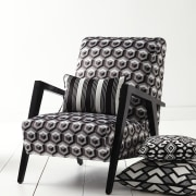 In modern commercial interiors, an eye-catching furnishing scheme black, black and white, chair, couch, cushion, furniture, loveseat, product, product design, sofa bed, white