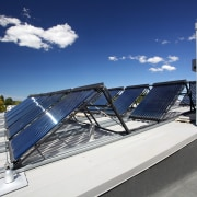 Forté Health is the first medical facility in architecture, daylighting, energy, roof, sky, solar energy, solar panel, solar power, technology, blue, gray