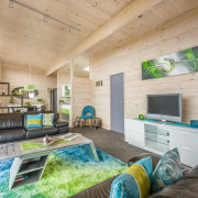 Wooden living area - Wooden living area - home, house, interior design, living room, real estate, gray, orange