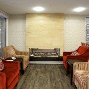 The flooring comprises individual planks that resemble natural ceiling, floor, flooring, furniture, hardwood, home, interior design, laminate flooring, living room, real estate, room, table, wall, wood, wood flooring, gray, brown