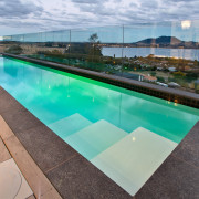 This modern lap pool, by Mayfair Pools and leisure, property, real estate, swimming pool, water, gray, teal