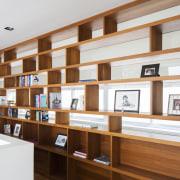 A few simple, assertive design strokes can transform bookcase, furniture, institution, interior design, library, shelf, shelving, white, brown