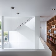 A few simple, assertive design strokes can transform architecture, daylighting, furniture, house, interior design, shelf, shelving, stairs, gray