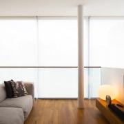 A few simple, assertive design strokes can transform floor, flooring, hardwood, hearth, interior design, living room, window, window covering, wood, wood flooring, white