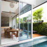 On this renovation by Ong & Ong, clear condominium, door, glass, house, interior design, property, real estate, window, white