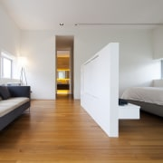 A few simple, assertive design strokes can transform architecture, bed, bed frame, bedroom, ceiling, daylighting, floor, flooring, furniture, hardwood, house, interior design, laminate flooring, real estate, room, suite, wood, wood flooring, gray
