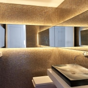 Mirrors wrap the walls in this powder room, architecture, bathroom, ceiling, countertop, daylighting, floor, interior design, real estate, room, orange, brown
