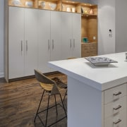 White lacquered doors were specified for the perimeter cabinetry, countertop, floor, interior design, kitchen, product design, room, gray
