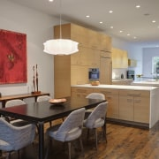 The peninsula serves as a buffet for the ceiling, countertop, dining room, floor, flooring, hardwood, interior design, kitchen, living room, real estate, room, table, wood flooring, gray
