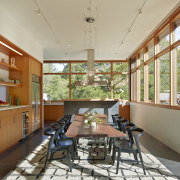 The open-plan family living area is a social house, interior design, real estate, window, orange, brown
