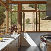 Kitchen in contemporary rural home architecture, cabinetry, countertop, cuisine classique, daylighting, door, home, house, interior design, kitchen, real estate, window, brown, gray
