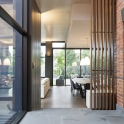 Strong contemporary lines characterise the new addition in architecture, floor, flooring, house, interior design, lobby, real estate, gray