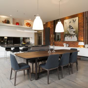 Strong contemporary lines characterise the new addition in dining room, flooring, interior design, kitchen, table, gray