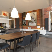 The older part of this renovated house is countertop, dining room, interior design, kitchen, real estate, table, gray