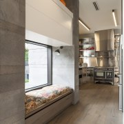 Strong contemporary lines characterise the new addition in architecture, floor, flooring, interior design, kitchen, loft, gray, brown