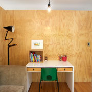 Pine plywood lines the interior of the black ceiling, desk, floor, flooring, furniture, hardwood, home, house, interior design, living room, plywood, product design, room, shelf, table, wall, wood, orange, gray, brown
