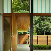 Green channel glass above the large pivot entry architecture, door, home, house, window, wood, brown, green