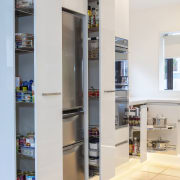 This small kitchen was completely transformed by kitchen furniture, shelf, shelving, white