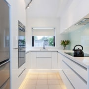 This small kitchen was completely transformed by kitchen ceiling, daylighting, floor, interior design, kitchen, property, real estate, window, gray, white