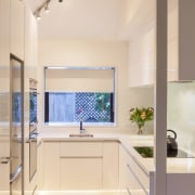 This small kitchen was completely transformed by kitchen architecture, bathroom, ceiling, countertop, daylighting, home, interior design, kitchen, real estate, room, sink, window, orange