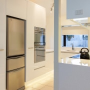 This small kitchen was completely transformed by kitchen home appliance, interior design, kitchen, real estate, orange, gray