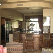 The kitchen was designed so that several people cabinetry, ceiling, countertop, flooring, furniture, interior design, kitchen, room, brown