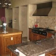 In the original kitchen, the cooktop was against cabinetry, countertop, cuisine classique, floor, flooring, interior design, kitchen, property, room, brown