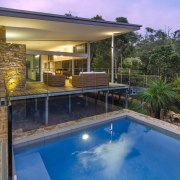 This new house in Margaret River is positioned backyard, estate, home, house, leisure, outdoor structure, property, real estate, resort, swimming pool, villa, brown